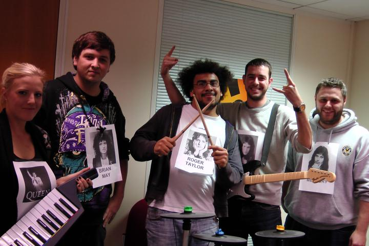 Staff in Claims take part in a Rockband contest