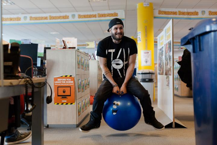 Staff in Swansea take part in a MOF space hopper race
