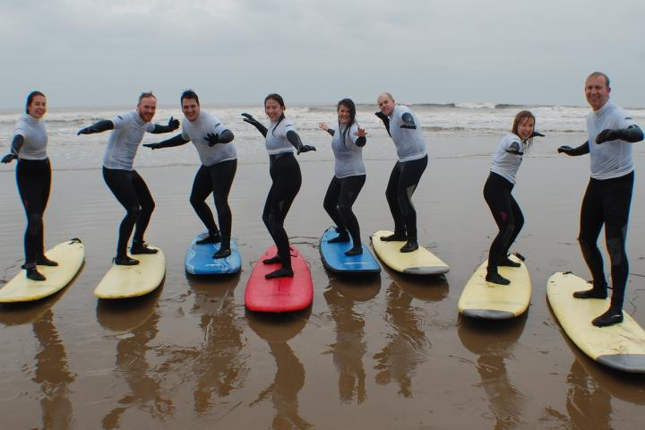 Staff enjoying a team afternoon out surfing